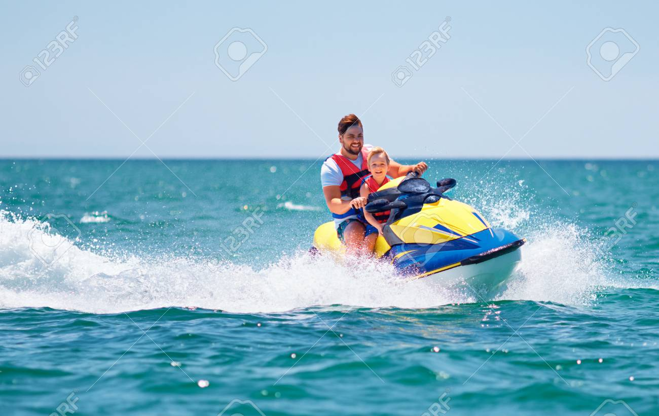 Happy Excited Family Father And Son Having Fun On Jet Ski At Stock Photo Picture And Royalty Free Image Image 105349441