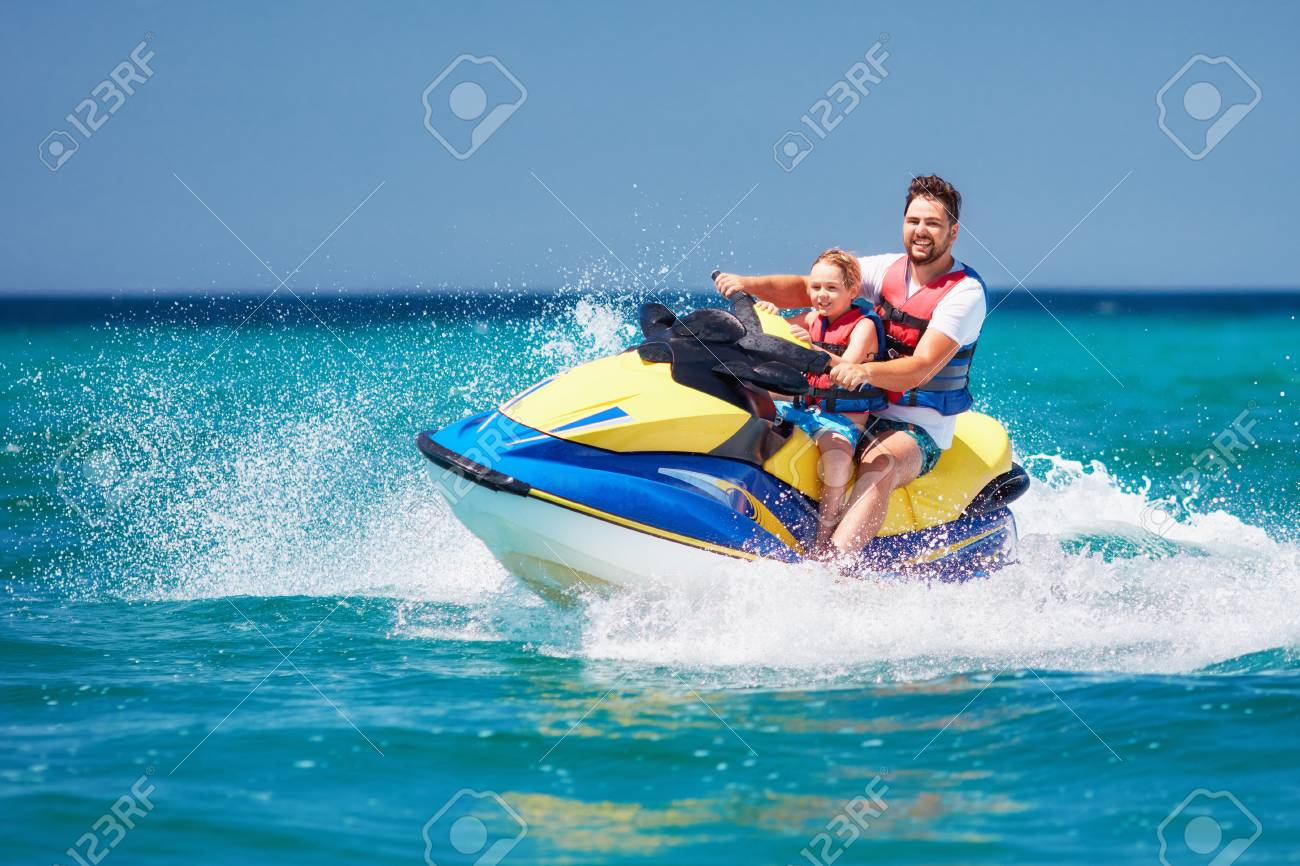 Happy Excited Family Father And Son Having Fun On Jet Ski At Stock Photo Picture And Royalty Free Image Image 105349462