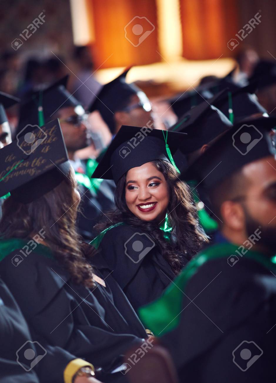 group of happy graduate students in gowns on graduation ceremony - 106236233