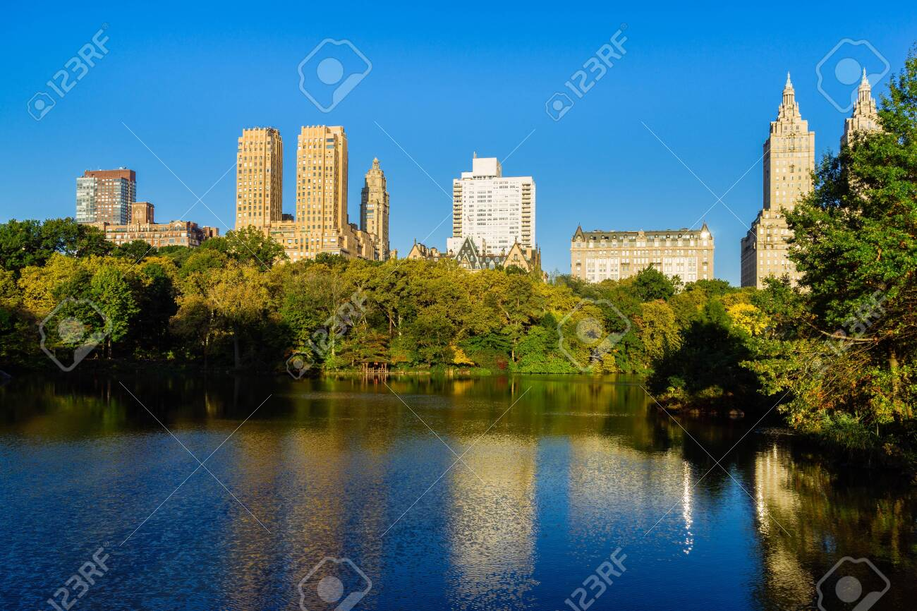 Skyline with apartment skyscrapers over lake in Central Park in midtown Manhattan in New York City - 151395386