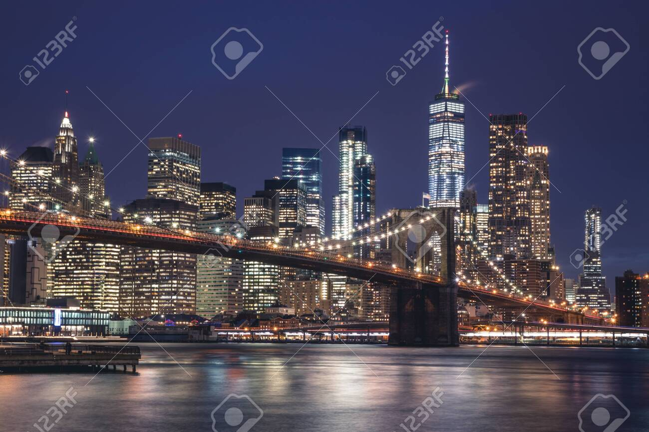 Views of the Brooklyn Bridge. Its a famous and iconic bridge in New York which passes the east river. - 143247763