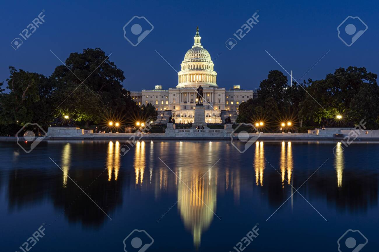 Capitol hill building at night illuminated with light with lake reflection Washington DC. - 148212469