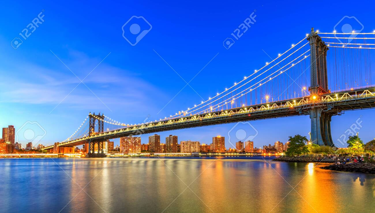 Manhattan Bridge in New York City. is a suspension bridge that crosses the East River in New York City, connecting Lower Manhattan with Downtown Brooklyn. - 148298575