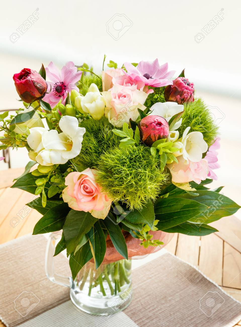 62e7a827a4 Large beautiful pink bouquet of peonies, roses, anemones, white freesia in a  vase