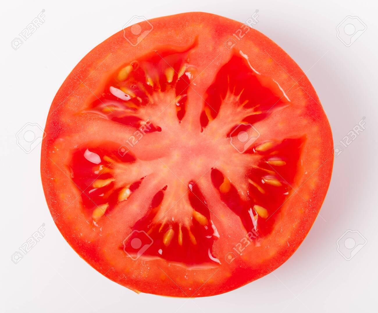 Slice of fresh tomato closeup, isolated on white, - 148355191