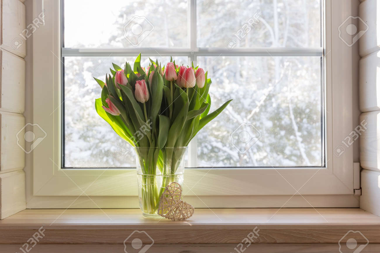 Bouquet of beautiful pink tulips on a wooden windowsill. White window in a Scandinavian style wooden house overlooking the garden, pine forest. Spring concept, Happy 8 March, Womens Day - 165243203