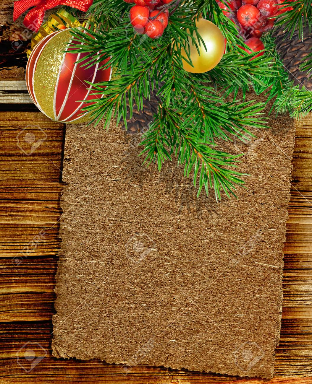 Old Paper Christmas Branch And Decorations On Wooden Background