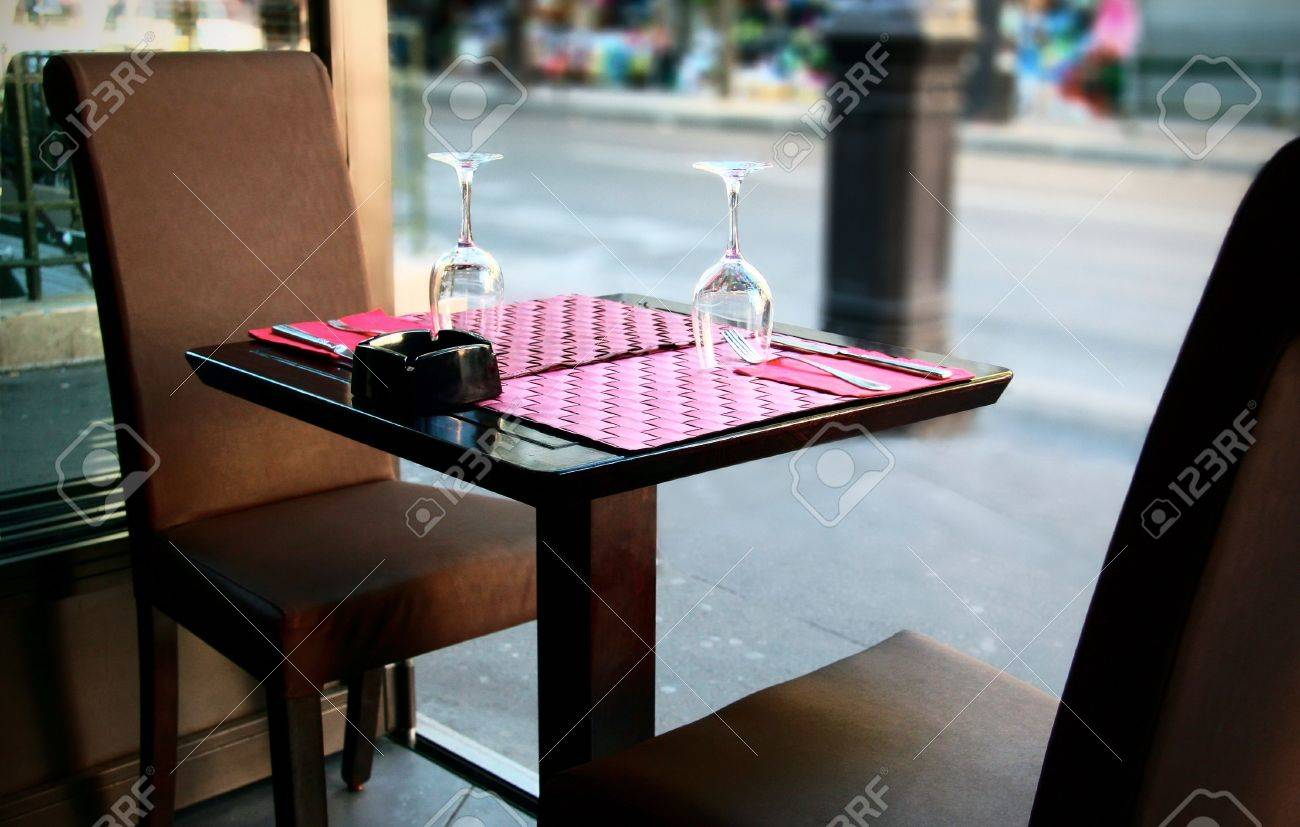 Restaurant table for two - Outdoor Restaurant In Paris France Europe A Table Set For Two Person With