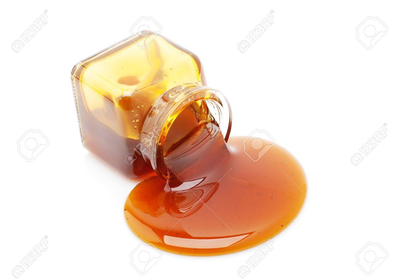 Honey spill from a glass jar isolated on white Stock Photo - 11975864