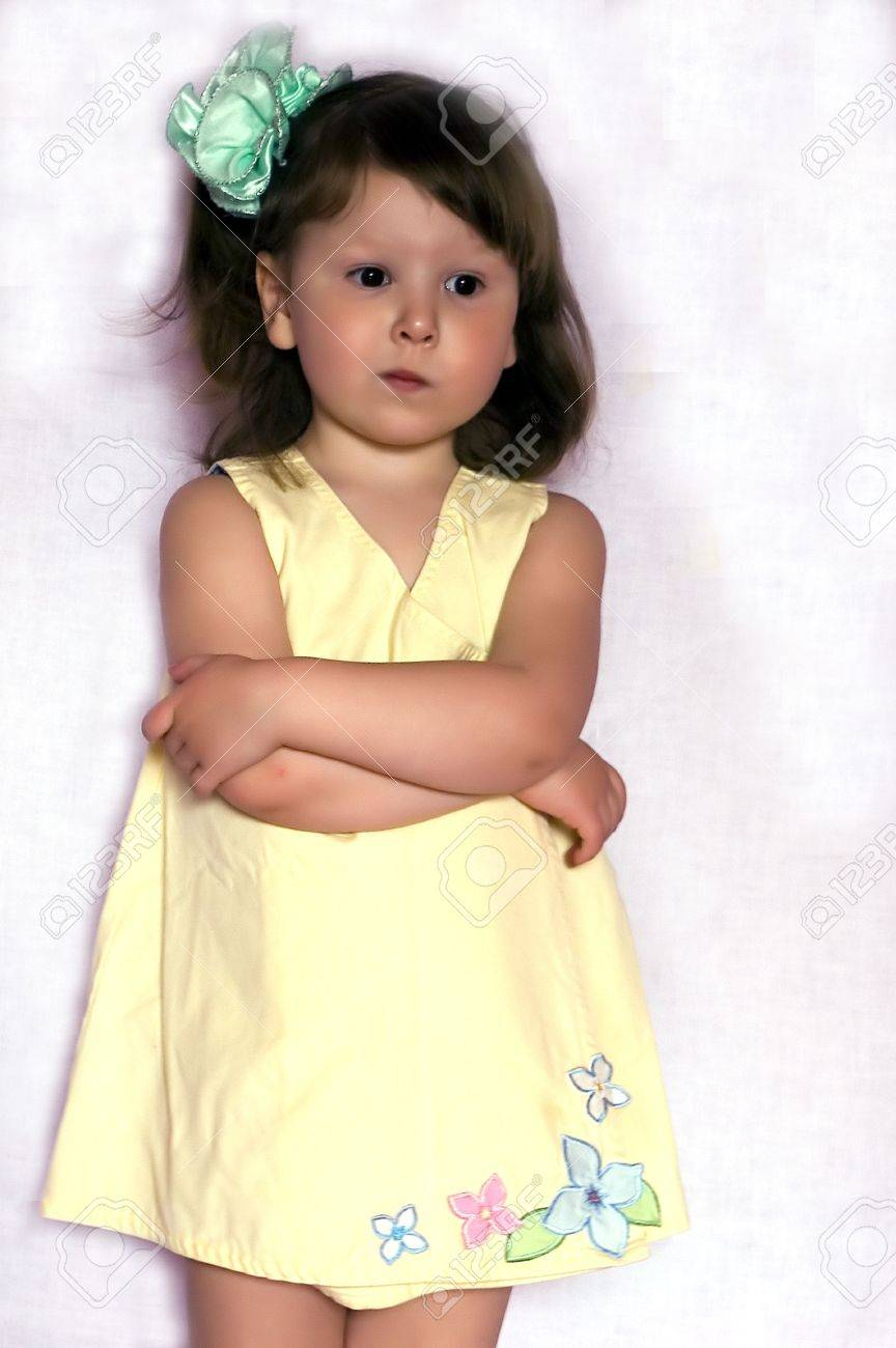 Sad Glamour Little Girl With Green Bow Wearing Yellow Dress With