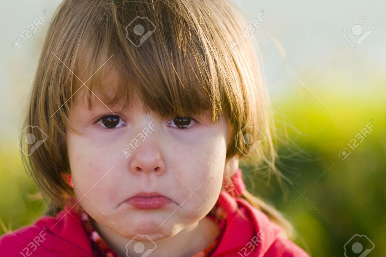 Portrait of crying little girl looking at you, tears filling her eyes, outsude Stock Photo - 1931922