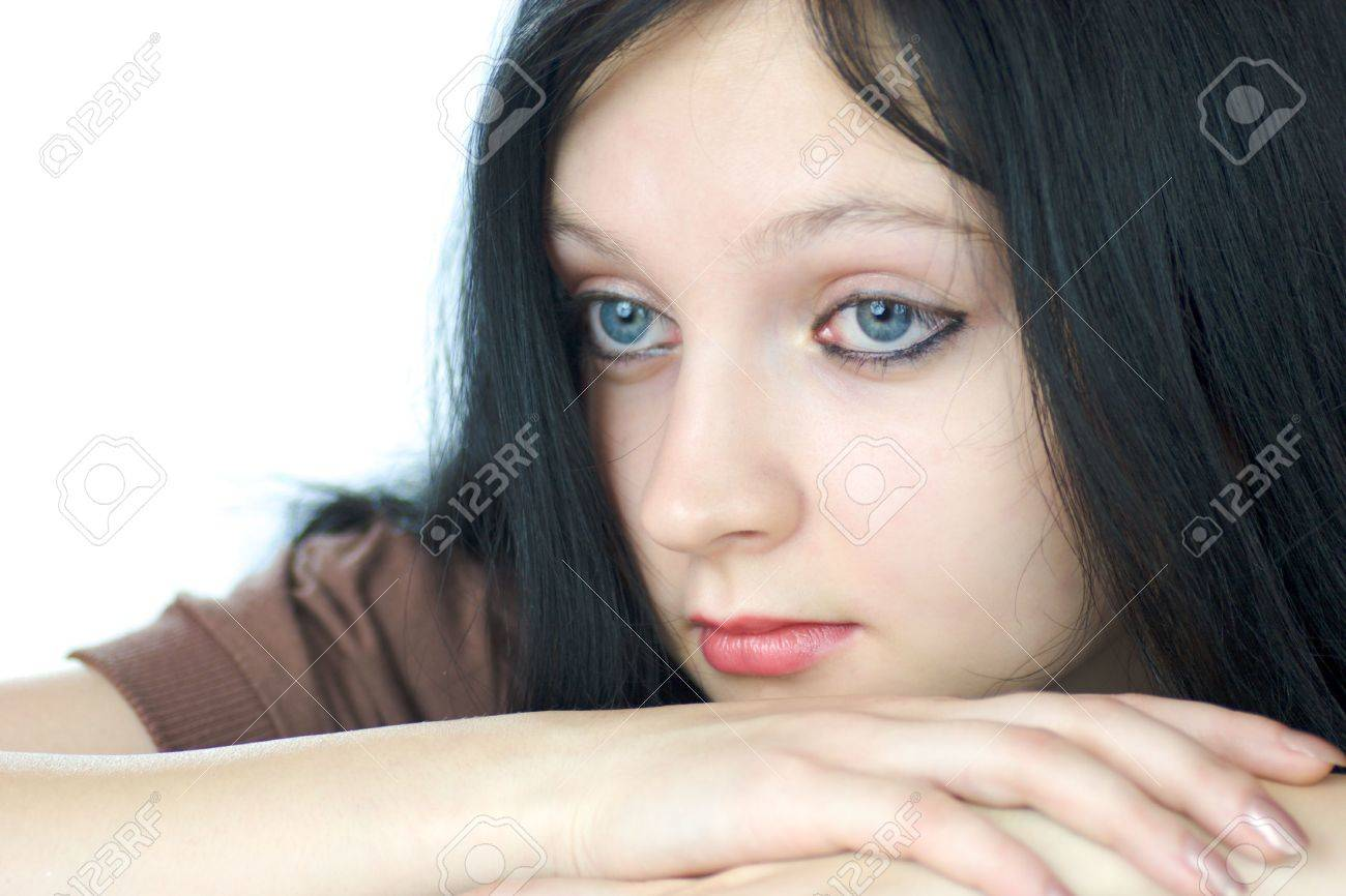 Portrait of pensive young woman with blue eyes lookiing away isolated on white Stock Photo - 2481534