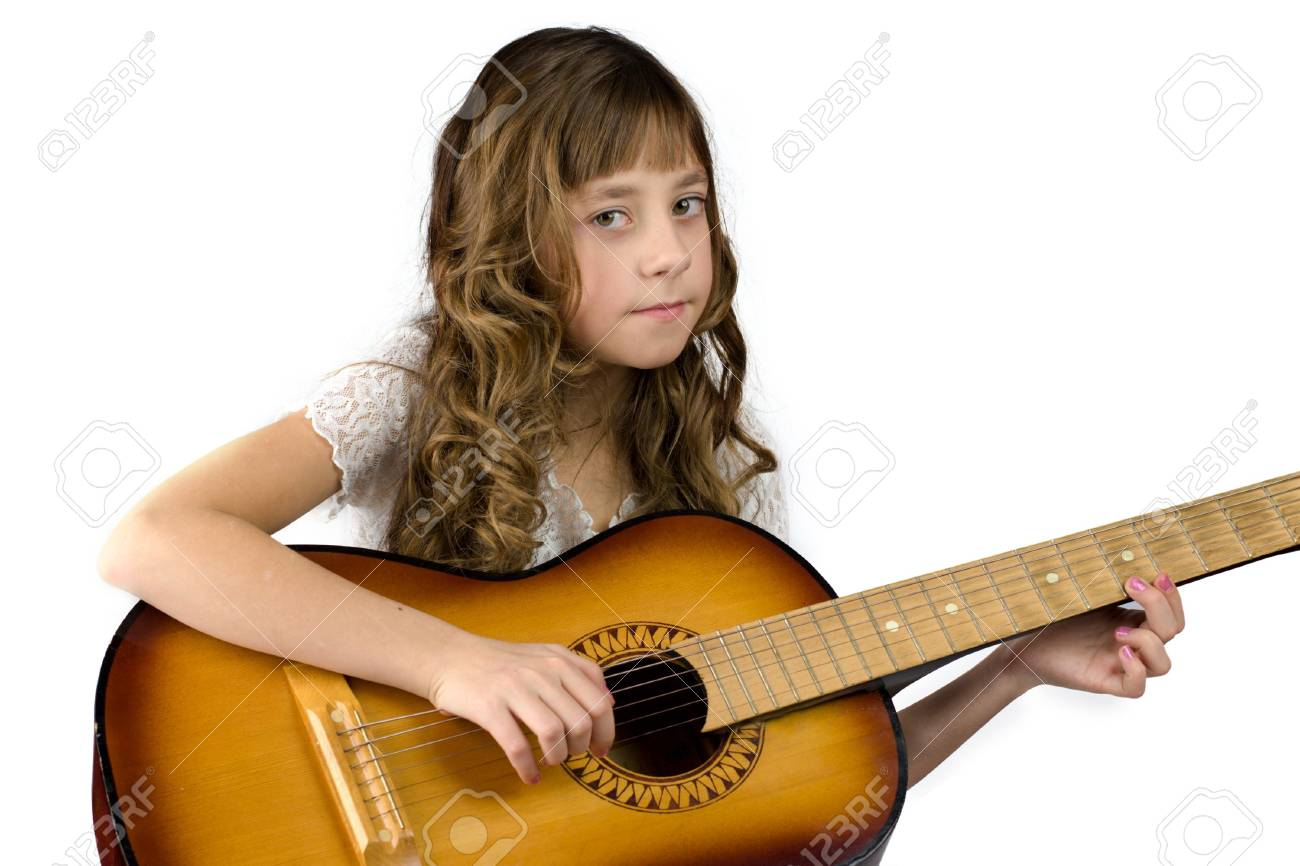 Girl with guitar looking at you isolated on white Stock Photo - 2507431