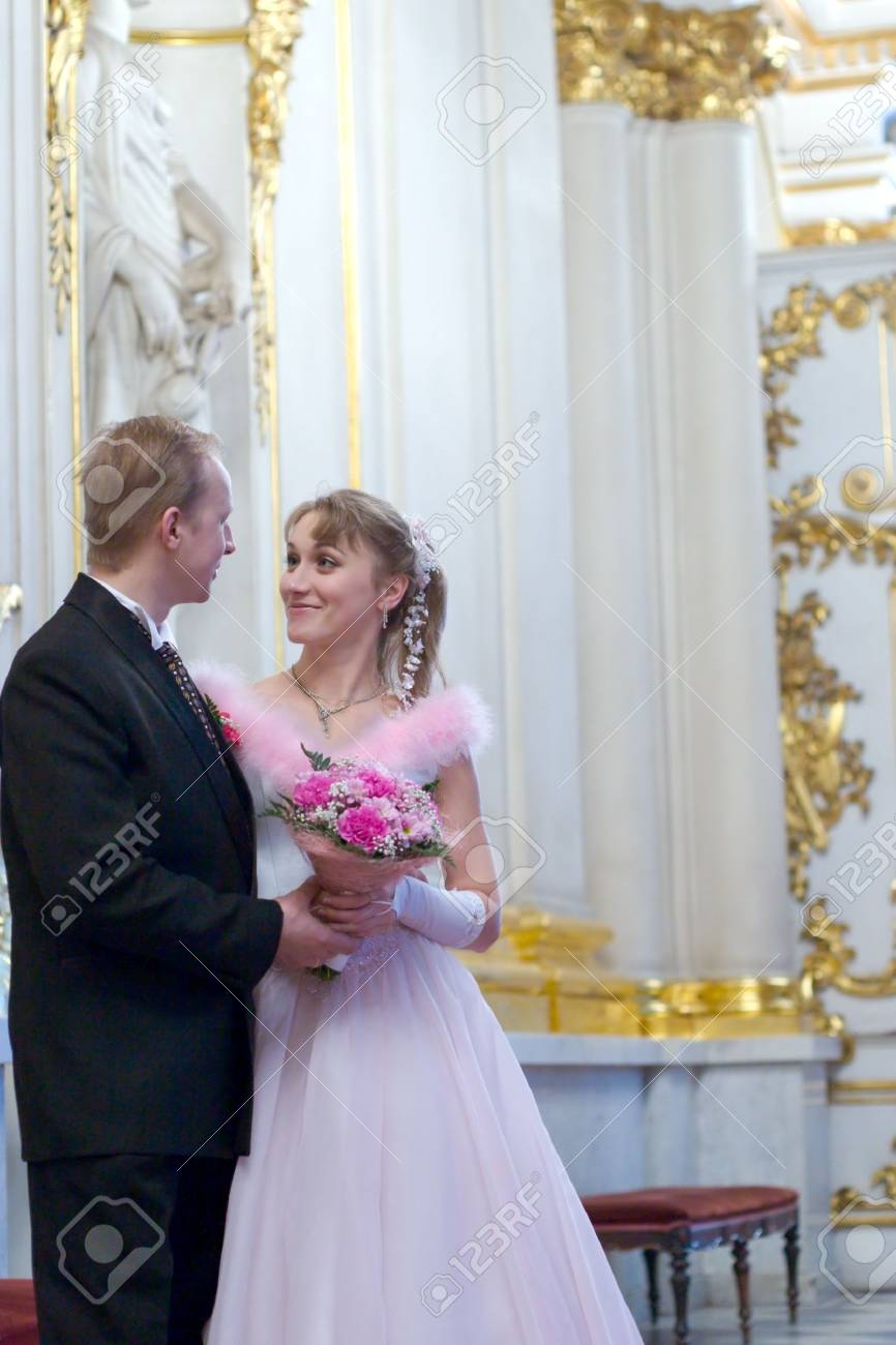 Bride and groom looking to each other indoors Stock Photo - 2630957