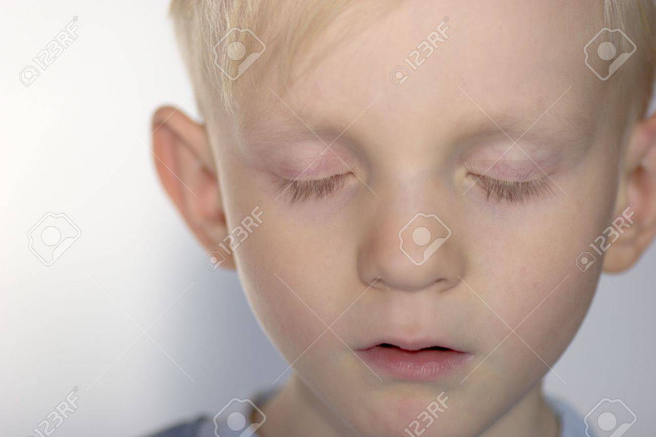 Closeup portrait of Upset child with his eyes closed Stock Photo - 2730585