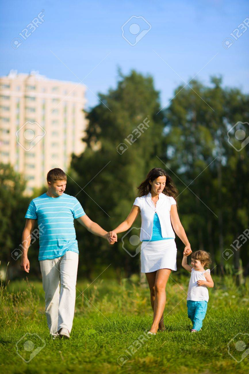 Happy Family walking in front of house outdoors Stock Photo - 6035866