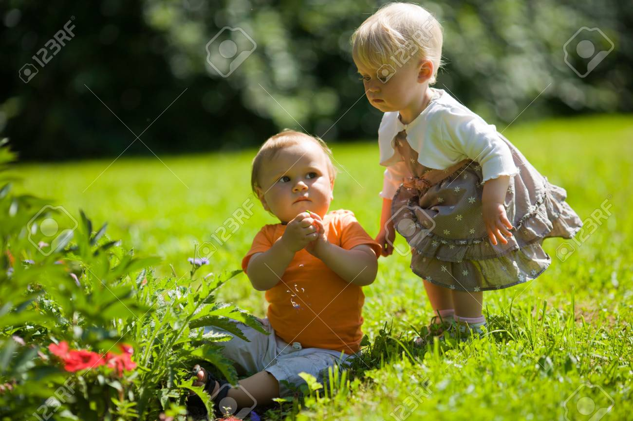 Two playing together kids outdoors in summer park Stock Photo - 6155491
