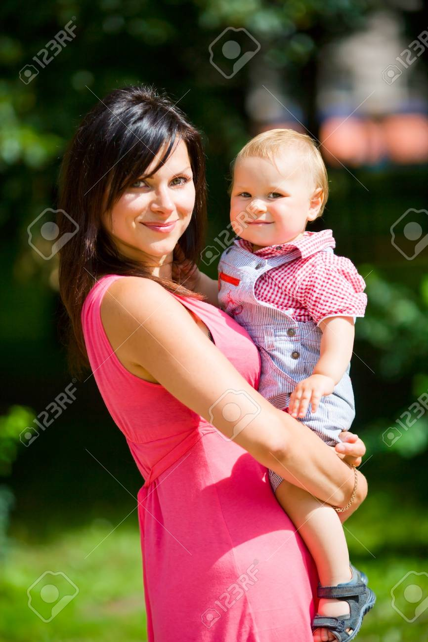 Happy mother holding one year son summer outdoors Stock Photo - 7240200