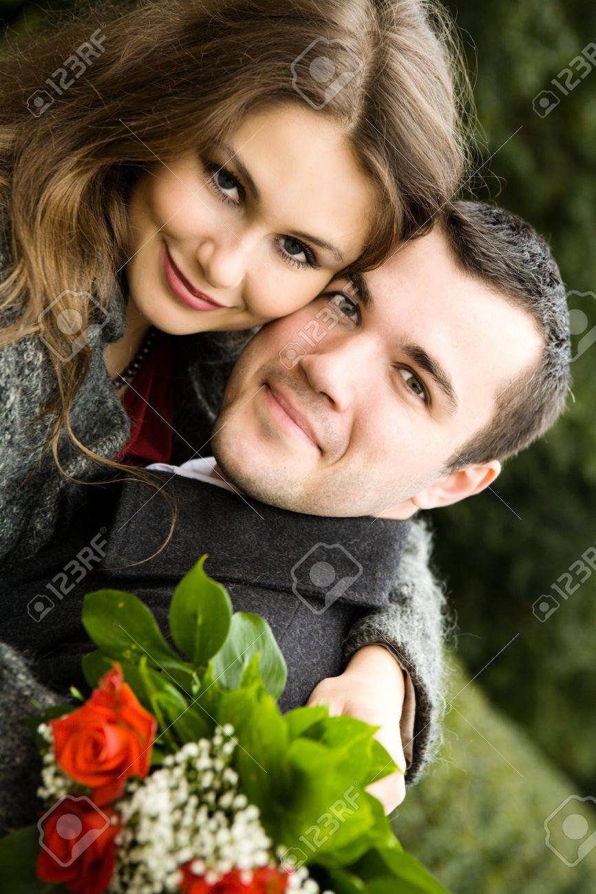 Two young lovers enjoying each other in park Stock Photo - 7811530