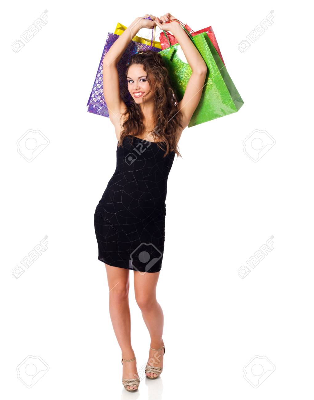 Young Woman shopping holding bags isolated on white Stock Photo - 8252410