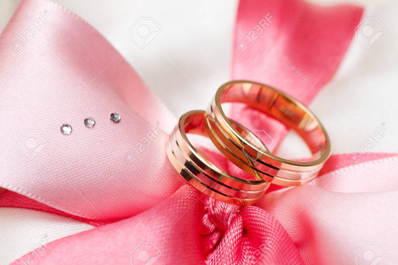 Two Golden Wedding Rings On Bow Macro Shot Stock Photo, Picture And ...