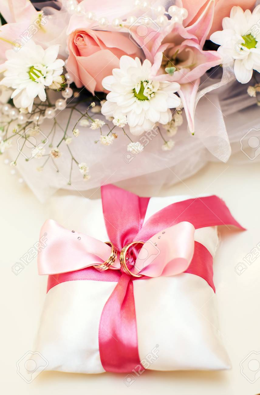Two Golden Wedding Rings On Pillow Stock Photo, Picture And Royalty ...
