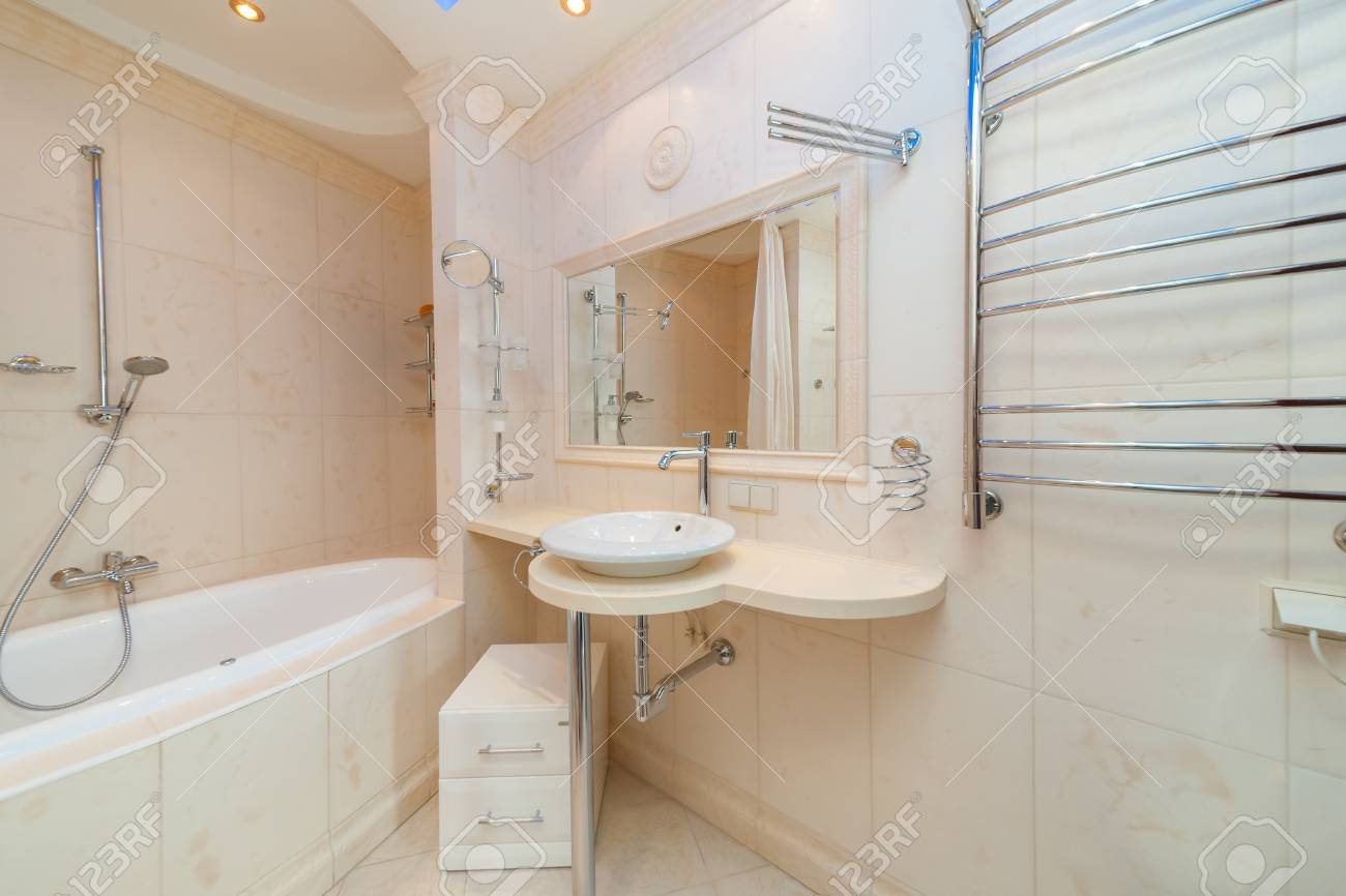 Small Beige Tile Bathroom With Bath Tube And Sink Stock Photo ...