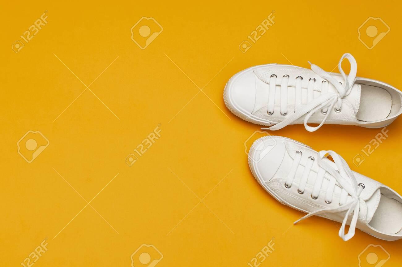 White Female Fashion Sneakers On Yellow