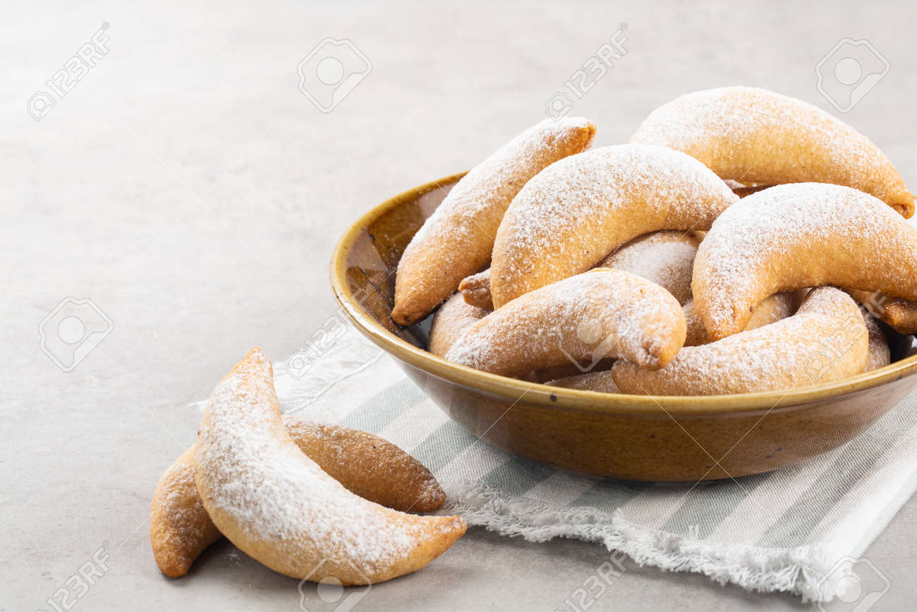 Homemade crescents stuffed with walnuts and choccolate. White background. Close up. Copy space. - 160480514