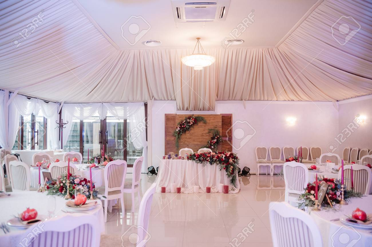 Beautifully Decorated Wedding Hall In White And Red Colours Stock