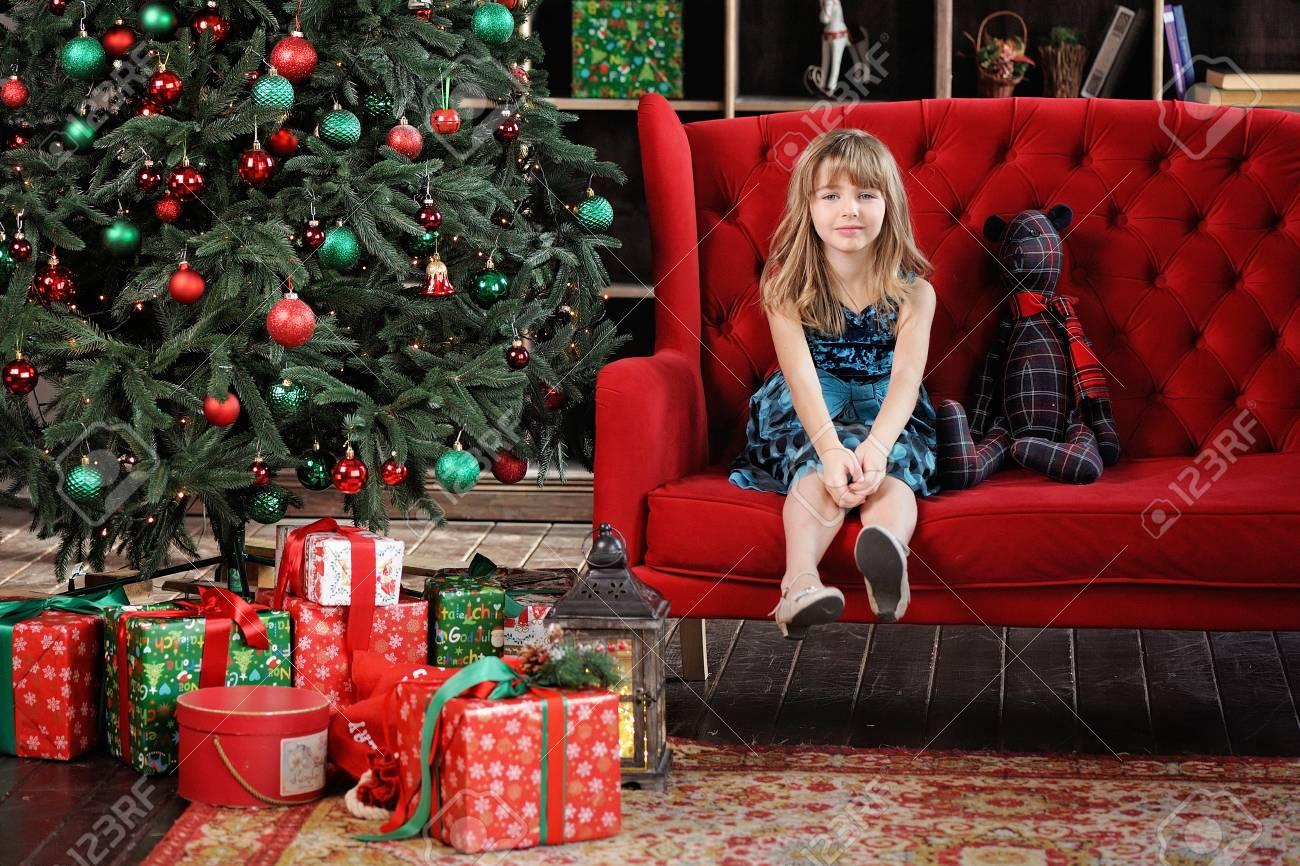 Merry Christmas. Pretty Young Girl Near Christmas Tree Stock Photo ...