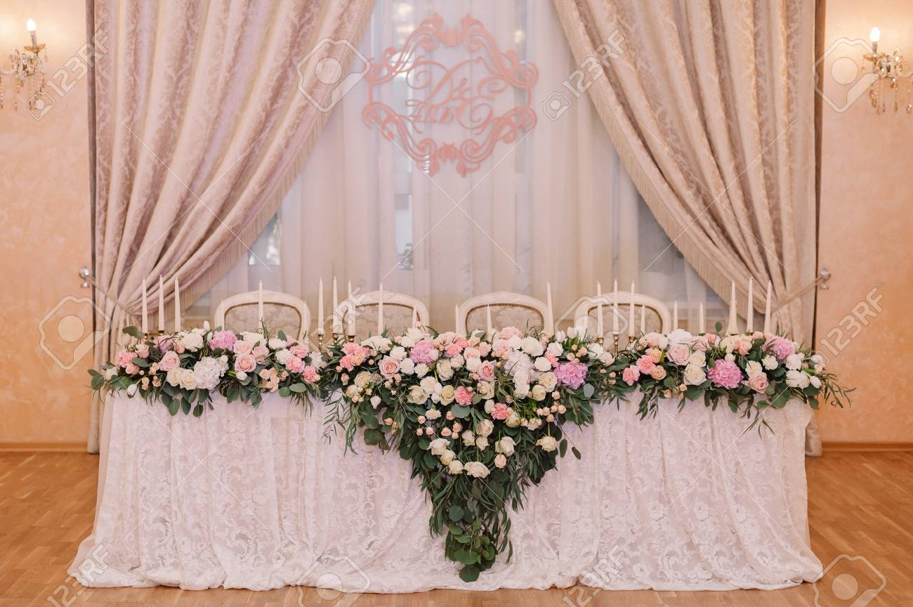 Wedding Table Decoration With The Coat Of Arms In Light Pink