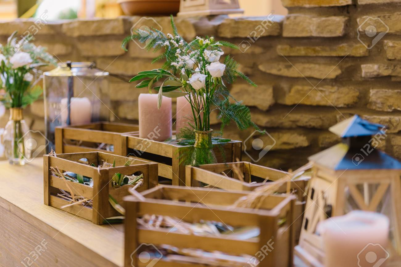 Wedding Decoration Of The Restaurant With Wooden Boxes And Flowers