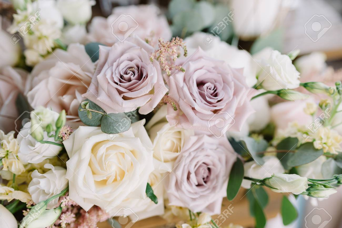 Magnificent wedding floristics. Decorating of a wedding in flowers. Flower background - 104144191