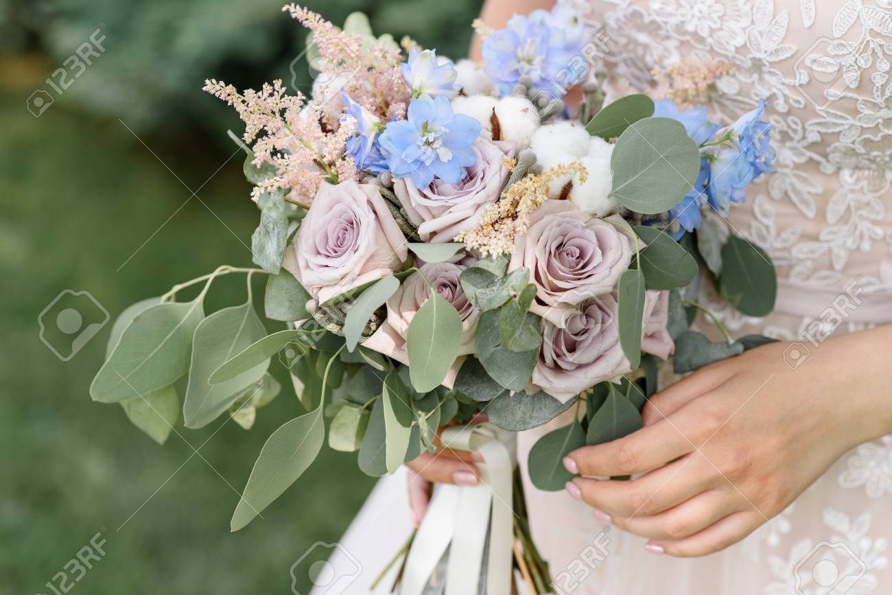 Wedding Bouquet From Roses With Branches Of Cotton And An Eucalyptus