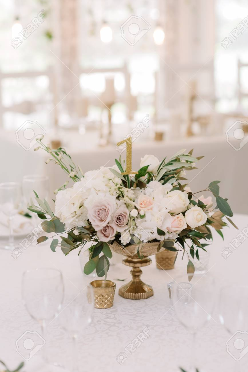 Beautiful Flowers In A Golden Vase On A White Table Magnificent Stock Photo Picture And Royalty Free Image Image 106297030