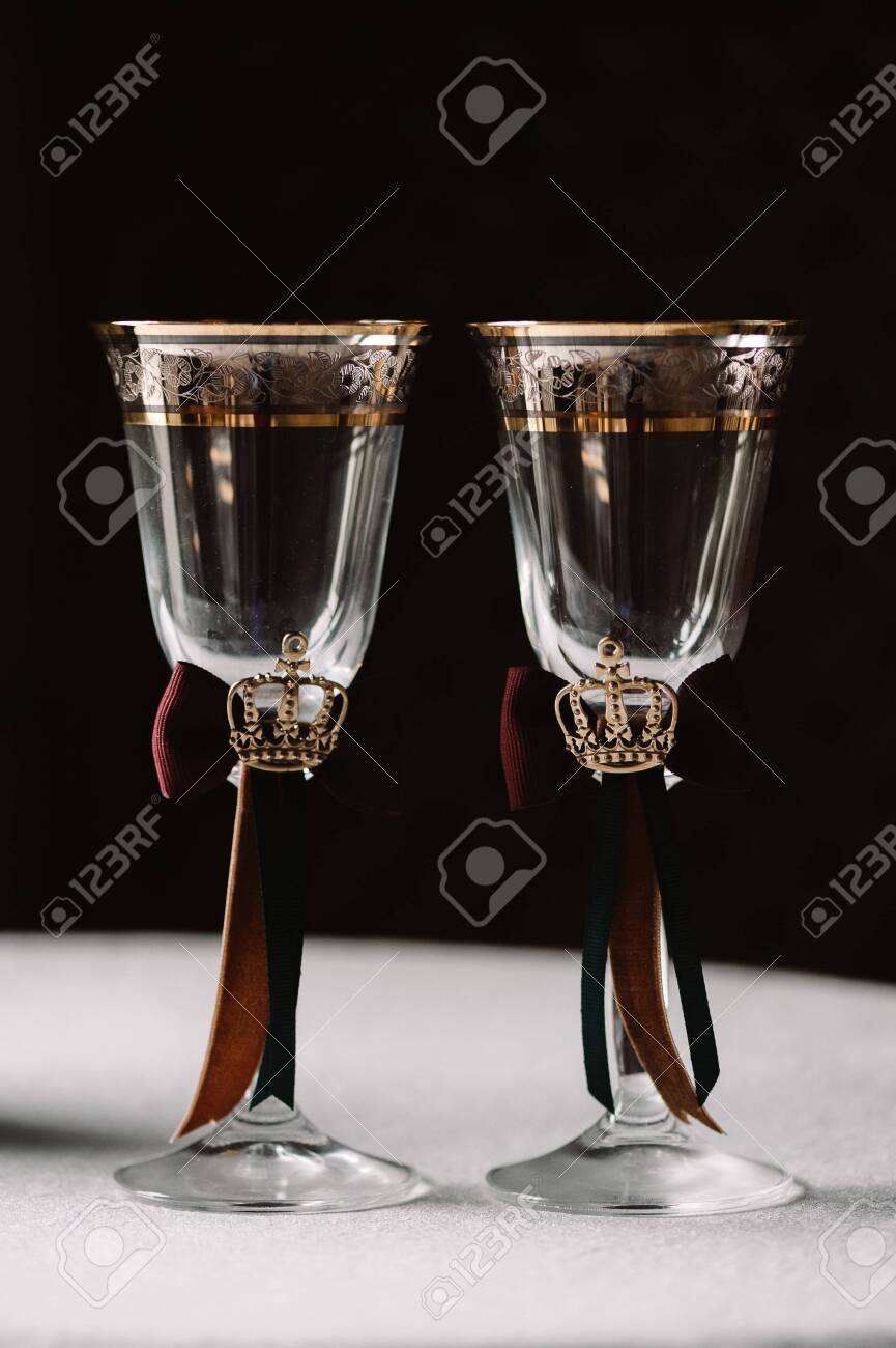 Wedding Decorated Champagne Glasses With The Crown Green And