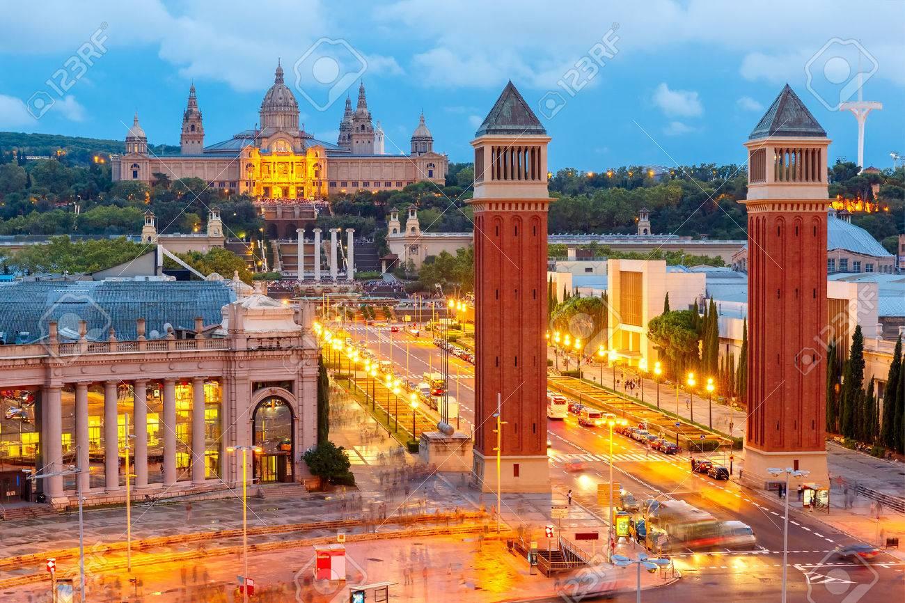 Aerial view of venetian columns, National Art Museum and Placa Espanya in Barcelona at night, Catalonia, Spain - 47011410