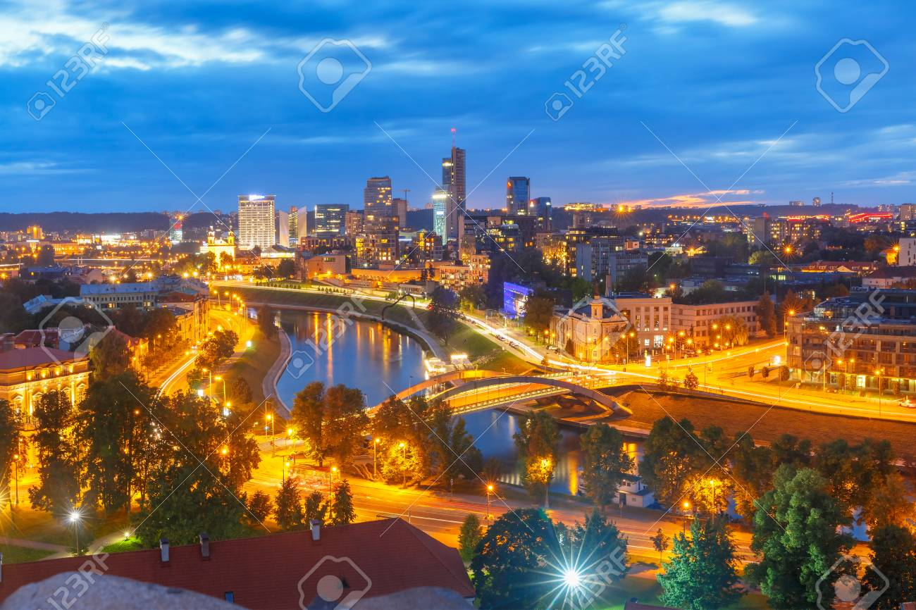 Aerial panoramic cityscape with skyscrapers of New Center of Vilnius from Gediminas Tower at night, Lithuania, Baltic states. - 62634484