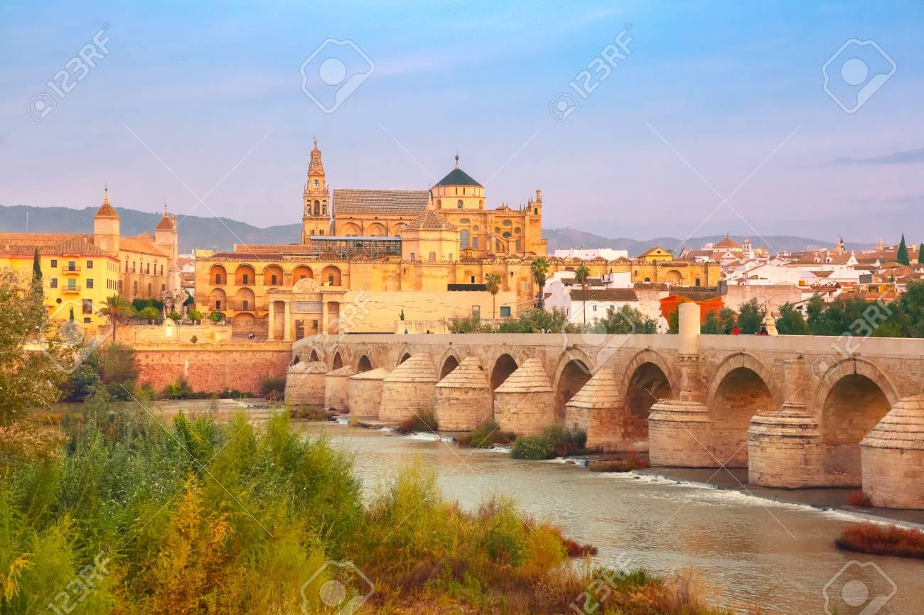 Great Mosque Mezquita - Catedral de Cordoba and Roman bridge across Guadalquivir river in the morning, Cordoba, Andalusia, Spain - 73864581