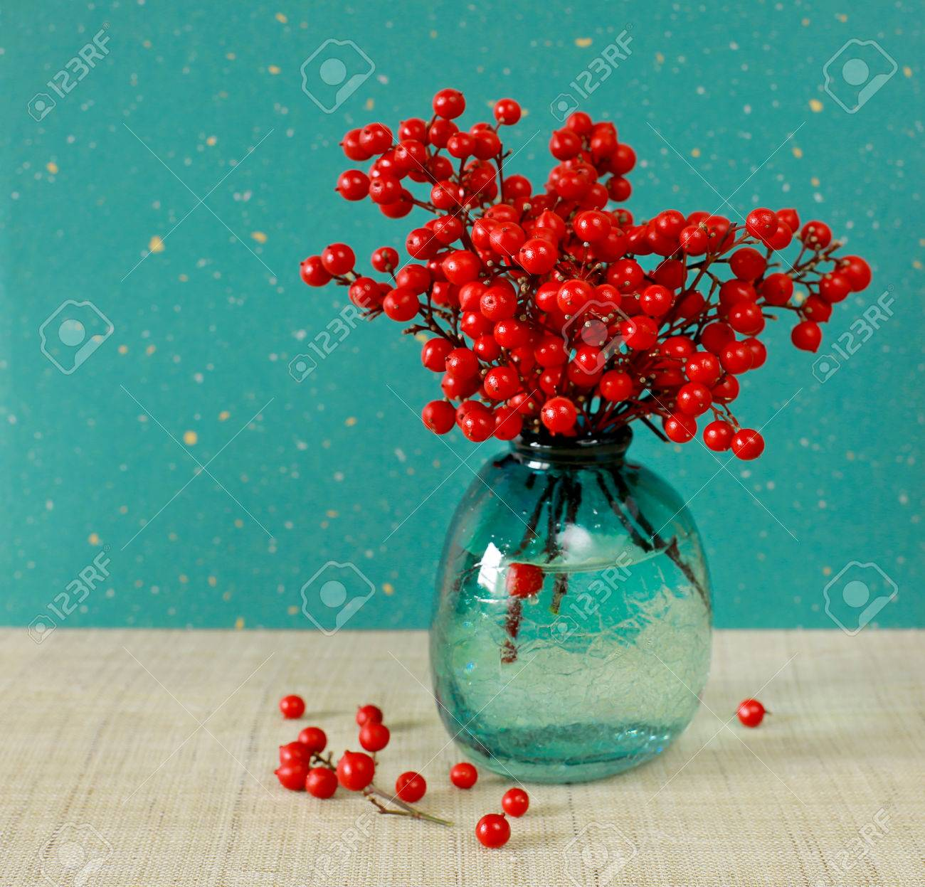 Japanese Vase With Red Berries Of Sacred Bamboo Nandina Domestica With  Colorful Japanese Paper On The