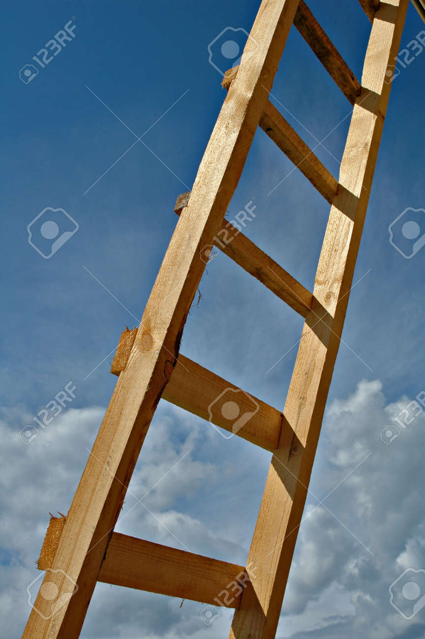 New Wooden Ladder On A Background Of The Sky With Clouds Stock Photo Picture And Royalty Free Image Image 3351712