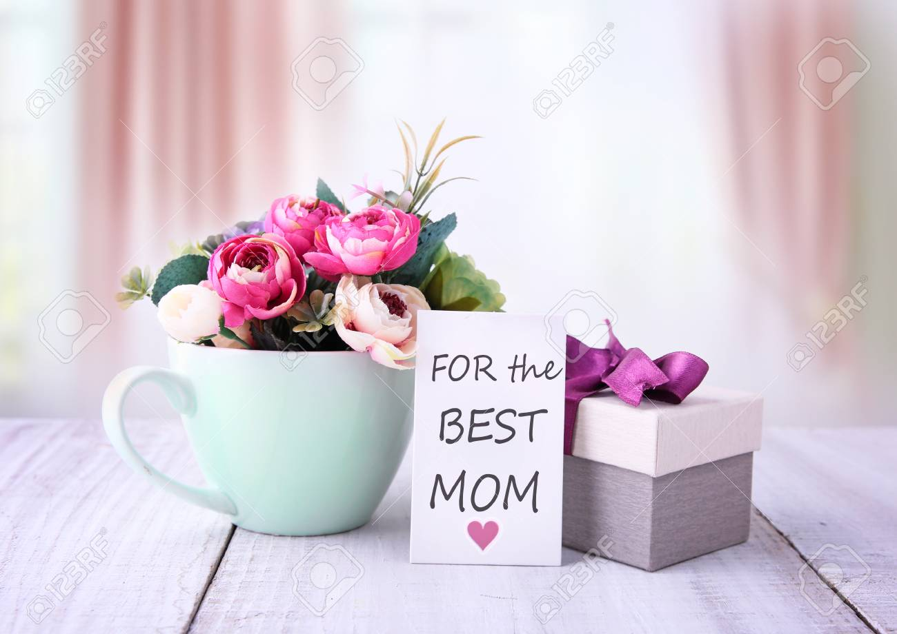Mothers Day Greeting CardBirthday Gift Box With Flowers On Wooden Table Stock Photo