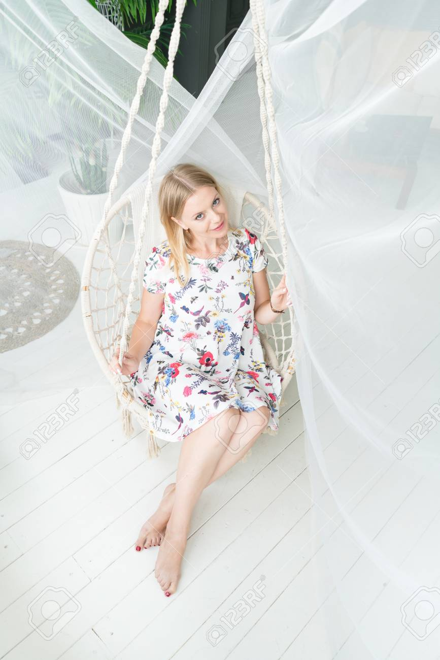 Sensational Lifestyle Concept Blond Girl Is Sitting In A Rocking Chair Pdpeps Interior Chair Design Pdpepsorg