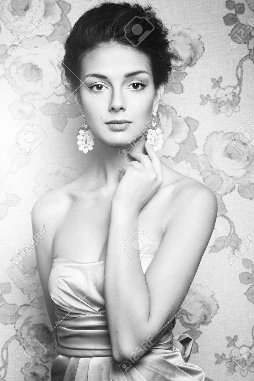 Black and white portrait of beautiful woman model with fresh makeup and romantic hairstyle beauty
