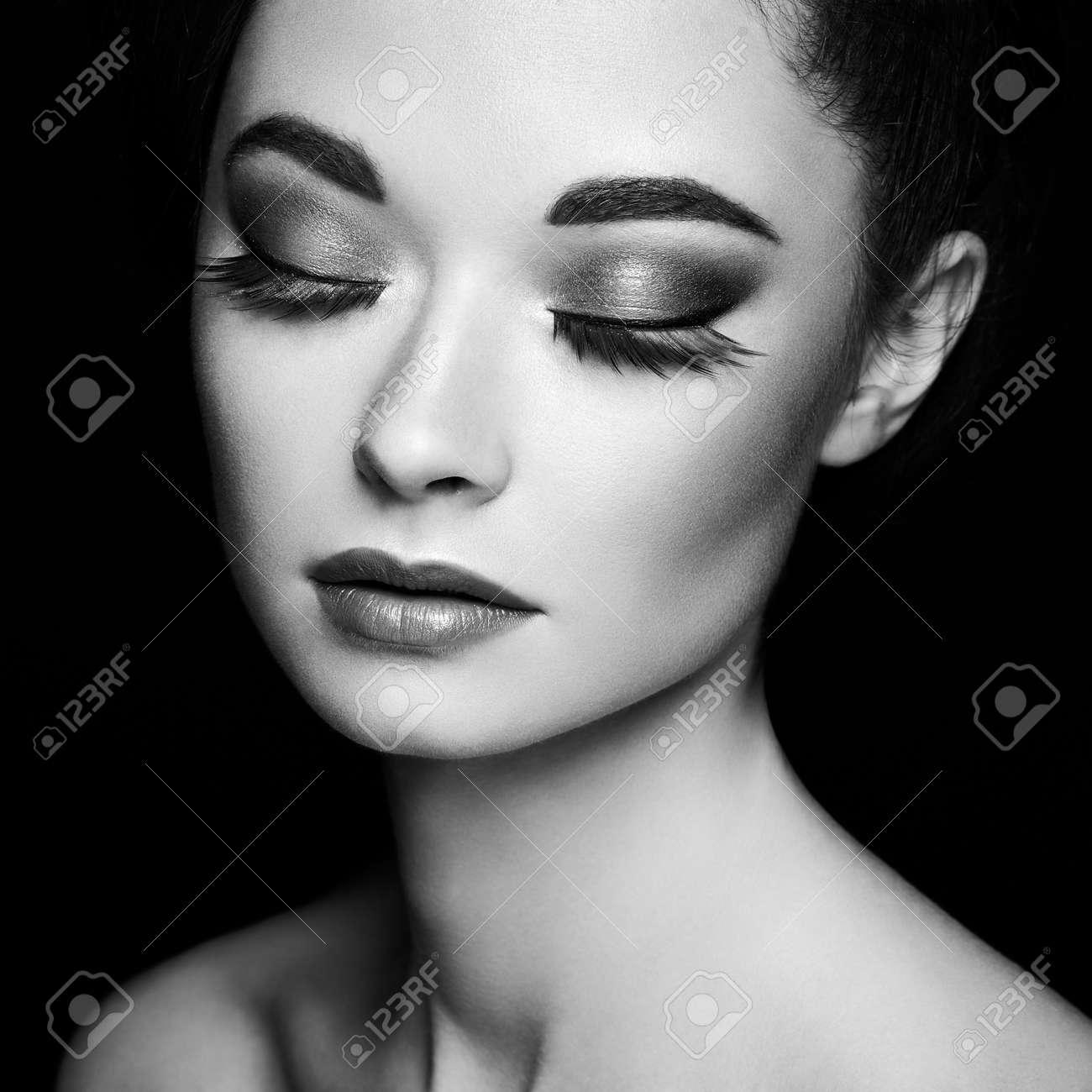 Beautiful woman face. Perfect makeup. Beauty fashion. Eyelashes. Cosmetic Eyeshadow. Black and white photo. - 150330650