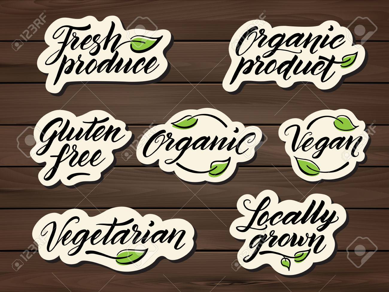 Hand drawn healthy food letterings. Label, badge, logo template on a wooden background. Eps 10 vector. - 57336153