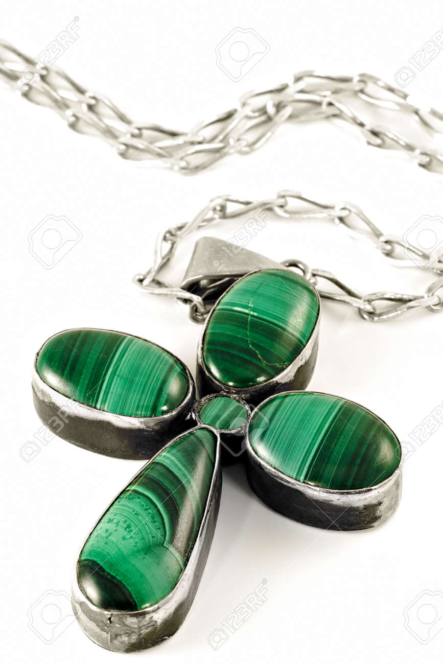 Stylized under fourleafed clover female ornament gem-malachite cross on a silver chain Stock Photo - 781092
