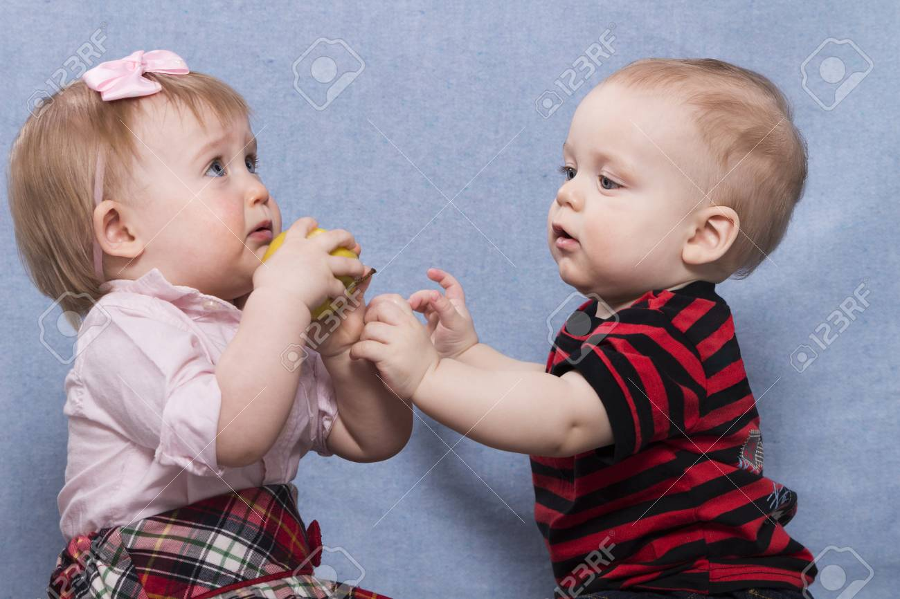 Cute Baby Boy And Lovely Baby Girl Playing Together Stock Photo