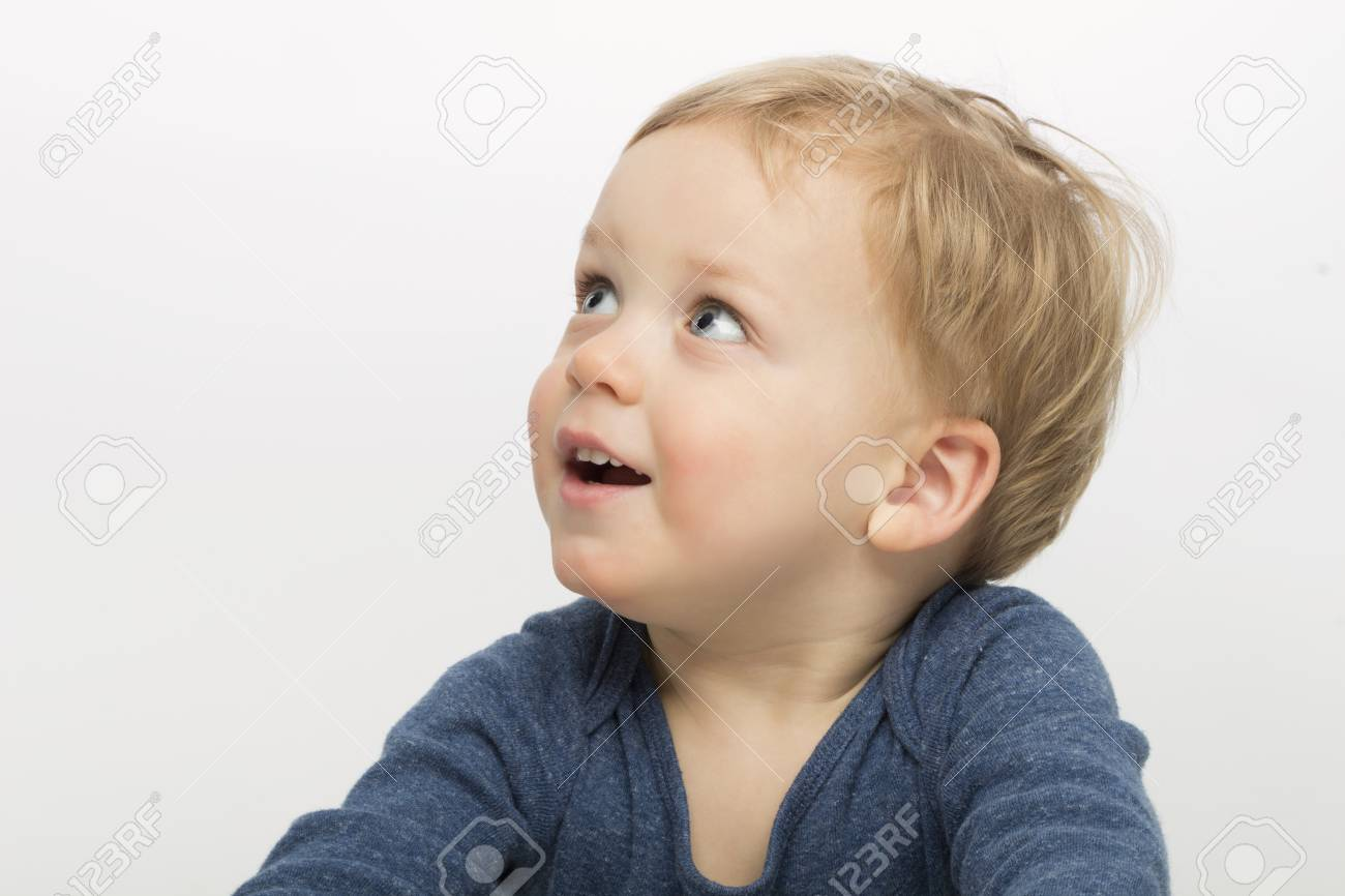 Stock photo surprised baby boy isolated on white background cute toddler with asking face expression adorable kid asking what is going on